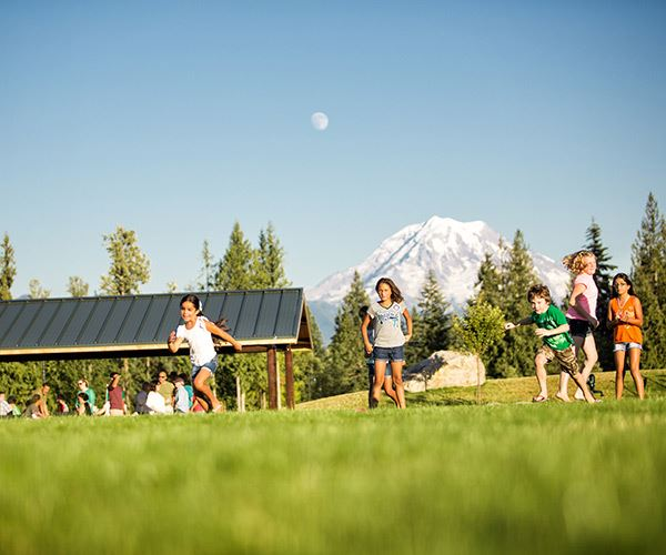 tehaleh-children-playing-in-the-field-with-Mount-Rainier-in-the-background.jpg