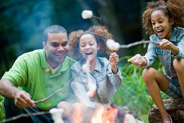 tehaleh-family-roasting-marshmallows-in-the-woods.jpg