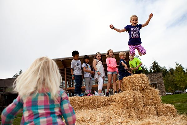 tehaleh-girl-jumping-on-haystack.jpg
