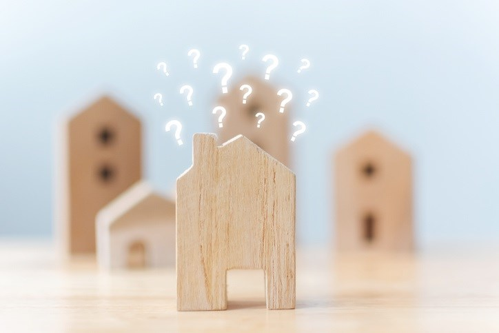 Wooden blocks with question marks representing mortgage questions.