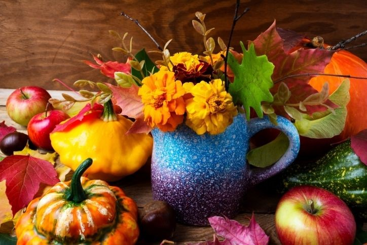 Colorful fall decorative leaves, fruits and vegetables.